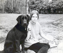 Barbara as a girl with her black Lab