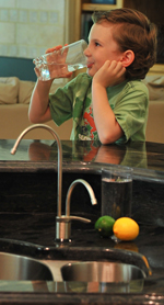Young Boy drinking ionized water by kitchen sink!